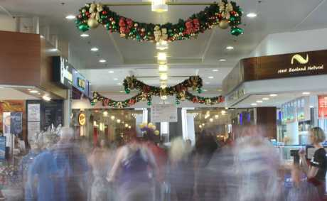 Crowds of people busily begin to do some last minute Christmas shopping at Sunshine Plaza.