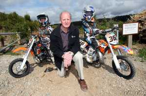 Western Bay Mayor Ross Paterson, flanked by young off-road riders Wade Meredith and Alex Fraser-Brown, shortly before the boys took off for their first taste of the new trail bike track at TECT All Terrain Park.