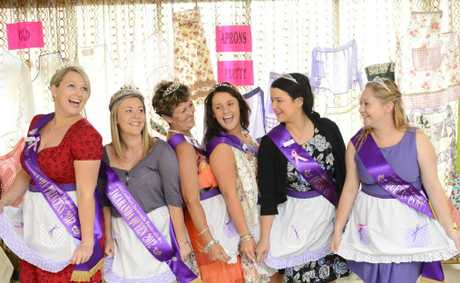 Jacaranda Princess Jenna Atherton, queen Sara Filewood, Matron Of Honour Pauline Glasser, holiday princess Sharni Rouse, Arcana Benke and Tara Lavelle-Skinner ham i up while showing off their best aprons as part of the apron display at the Jacaranda Afternoon Tea Photo Adam Hourigan / The Daily Examiner