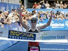 Melissa Hauschildt (Rollison) raises her arms in triumph as she crosses the finish line to win last year's Noosa Triathlon.