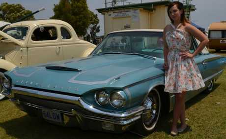 VINTAGE REVIVAL: Katee-Lou Hansen is dressed to impress while posing with a 1964 Ford Thunderbird.