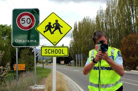 GOTCHA! Constable Nayland Smith, of Omarama police, with Kurow and Oamaru officers, has been deployed around the Omarama School zone until Friday in an effort to to get drivers to slow. PHOTO/REBECCA RYAN