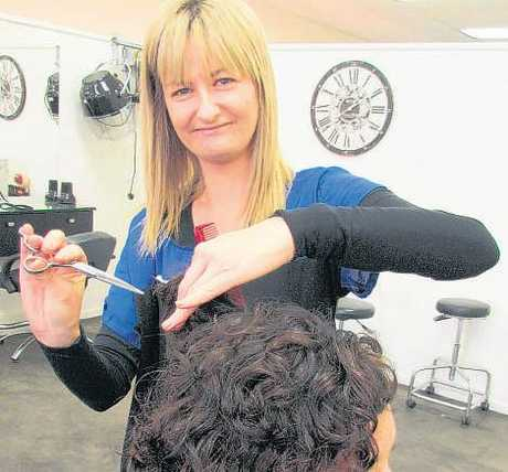Award-winning hairdresser Kim Walsh in action, showing her skills on beautician Leah Macdonald.