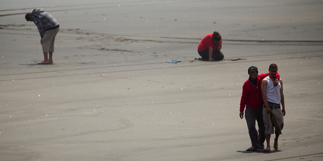 Members of the drowned man's family on Muriwai Beach.