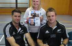 Rosie Jenkins came prepared with a photo for her favourite player. Sam Cane(right) to sign. Also in demand for autographs was Cory Jane. PHOTO/ Peter de Graaf