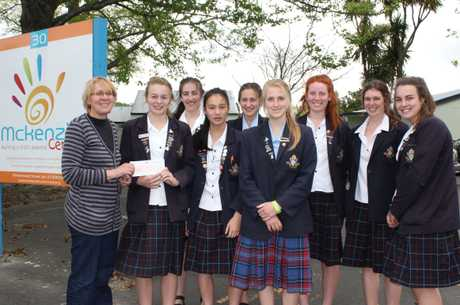 Student charity: McKenzie Centre Director, Trisha Benge is handed a $2000 cheque from Dio Events Council members (from left) Kate Nicol-Williams, Kate Williamson, Maria Tims, Lily Brown, Stephanie Kibblewhite, Georgina Short, Georgia Sweet, and Jessica Wooller.