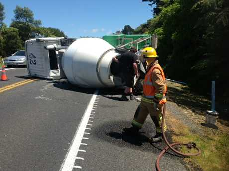 Concrete truck rolls on SH2