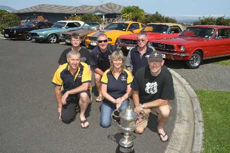 Bay of Plenty Mustang Owners' Club members, back, from left: Geoff Church, Jeff Wilson and Glen Fitzpatrick; front, from left: Gus Old, Debra Coombes and president Grant Robb with the Top Gun Trophy.