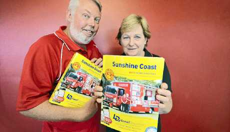 Bruce and Denise Morcombe and the 2013 Local Directory phone books.