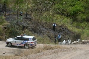 Police investigate the crash scene where Terry Kronk died near Helidon this morning.