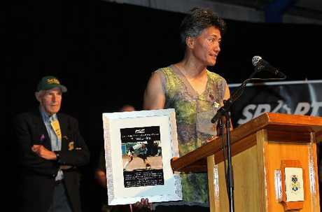 FIRST: Rhonda Hira speaks after being announced as the first inductee into the Central Hawke's Bay Hall of Fame at the Central Hawke's Bay Sports Awards in Waipukurau last night. Her father and coach, Ray Squire, listens. PHOTO/DUNCAN BROWN HBT120304-03