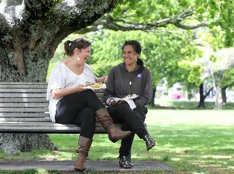 SHARED LUNCH: Hannah White and Angels Kaienua, 15, enjoy the Breaking the Bread community lunch at Kuirau Park.
