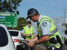 THE demotion of a drink-driving QLD police officer, who tried to influence junior officers not to give him a breath test, has been confirmed by a tribunal.