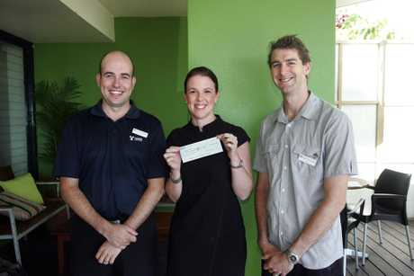 SCN311012charity1 Sunshine Coast Business Associates president Colin Mason and event organiser Tony Walton present Youngcare Event manager Bronwyn Glass with a $4000 cheque at the SCBA breakfast at Coolum's Sunrise Cafe. MIKE GARRY/ COOLUM AND NORTH SHORE NEWS
