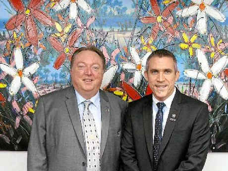 SPIRIT OF RECONCILIATION: Noosa MP Glen Elmes with artist David Hart with his work to bring two cultures together.