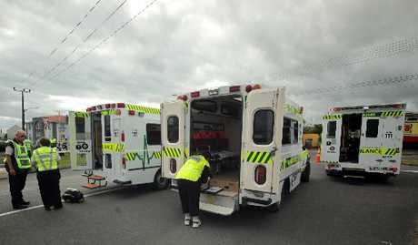 EMERGENCY: Ambulances wait outside Tasman Tanning's Castlecliff plant on Friday. Twenty-three people exposed to a toxic gas were taken to hospital.PHOTO/STUART MUNRO