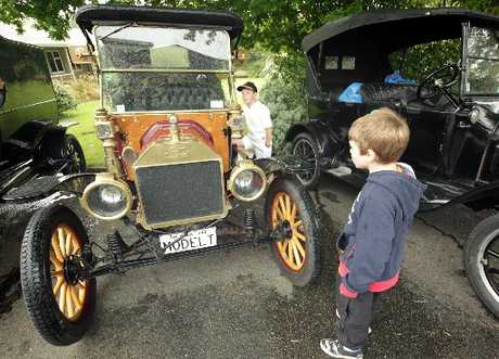 OLD SCHOOL: Bradley McDowell (left) and William McRae of Marton went to Huntley School to view Model Ts re-enacting a historic 1912 Wellington-to-Auckland journey.PHOTO/STUART MUNRO