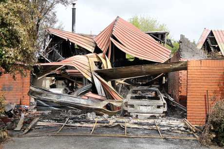 Fire damaged garage and house on Trices Road, Prebbleton.