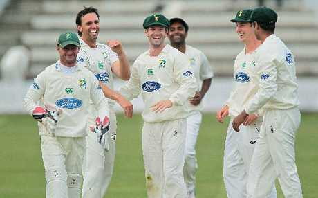 Carl Cachopa (centre) celebrates the wicket of Andrew Lamb, on his right, at Nelson Park, Napier.