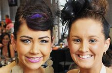 CUP STYLE: Brooke Kitching (left) and friend Laura Walsh revel in the good times at the Melbourne Cup function at the Ipswich Turf Club.