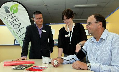 Health Hawke's Bay CEO Philip Grant, left, oversees registered nurse Fran Bayley, take Hawke's Bay Today general manager Russell Broughton's blood pressure. Photo / Duncan Brown