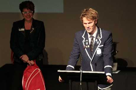 Thomas Jenkins thanks his supporters after receiving the Hawke's Bay Secondary Schools Sportsperson of the Year award from EIT's Brenda Chapman (left). Photo / Warren Buckland