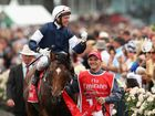 Brett Prebble riding Green Moon celebrates as he returns to the scales after winning the Emirates Melbourne Cup race during 2012 Melbourne Cup Day at Flemington Racecourse on November 6, 2012.