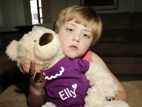 Ella Dennent keeps her travelling Epilespy Bear, Ella close to her. photo Vicki Wood