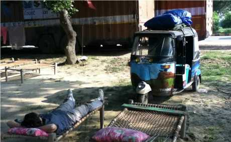 RICKSHAW ROVING: Kira Hartland takes a well-earned break during her trek through Northern India on a motorised rickshaw. Photo contributed.