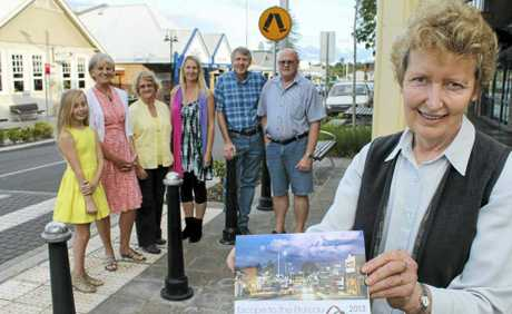 ON SALE: Alstonville-Wollongbar Chamber of Commerce president Lisa Dillon and the Plateau calendar, with some of the photographers whose work was chosen for the chamber's calendar.