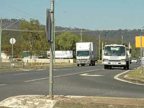 A shopping centre development in Withcott was approved under the condition that traffic lights are built at the intersection of the Warrego Highway and Jones Road.