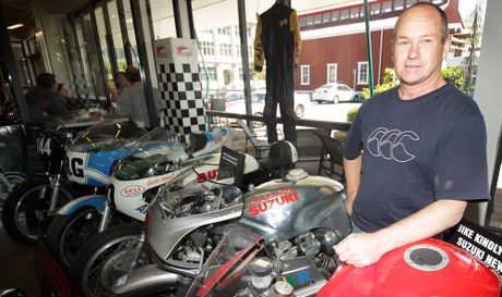 MEAN MACHINES: Cemetery Circuit motorcycle event organiser Allan &quot;Flea&quot; Willacy sets up shop at the i-Site in Wanganui. PHOTO/STUART MUNRO