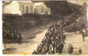 Waihi miners are escorted from the Waihi Mine - 1912.