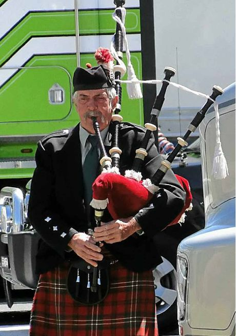 PIPED TRIBUTE: Bob Scott's bagpipes played to total and respectful silence at the Tarcutta Truckies Memorial. Photo: Graham Harsant