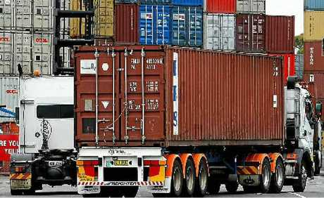 NEW LEVY: Container trucks arrive at Port Botanys maritime dock, a new bill will see the port privatised and a levy on drivers.