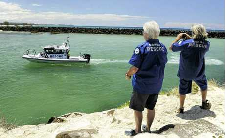 WELCOME: The new Brunswick Marine Rescue boat was greeted by local volunteers as it came over the bar at Brunswick Heads