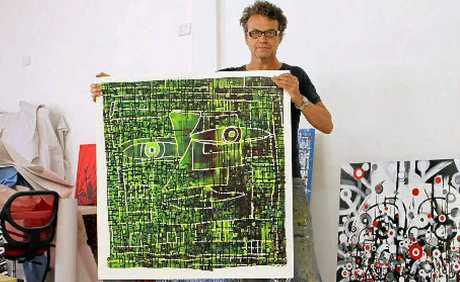 COLOURFUL CHARACTER: Jay Manby with Command Z, one of the works in Unwild, opening this Thursday night.