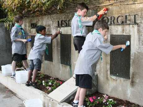 Cubs of the St Mary's Scout Group clean up the honours boards near the Cenotaph in Memorial Park, Hamilton East.