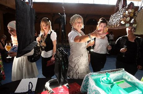 Among those checking out the handbags at Handbag Heaven were Nicola Ryan (second from left), Jo Harvey (centre) and Abby Traill (second from right). Photo / Ben Fraser
