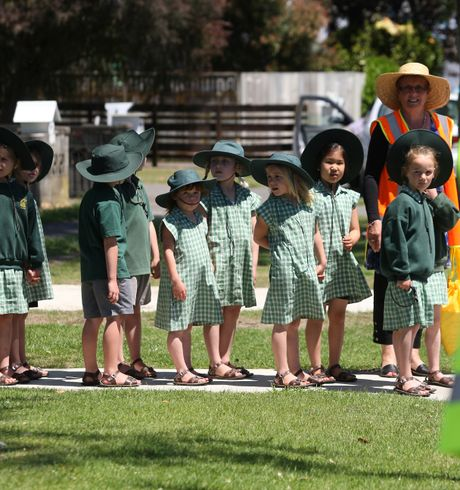 Students of St Mary's School take part in a tsunami evacuation drill on Fraser St.