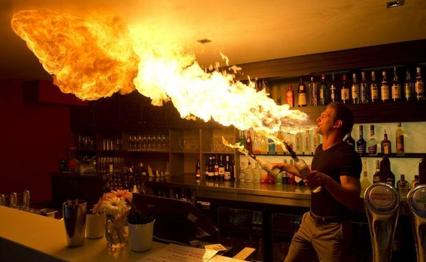 Bar manager Shane Finnegan impresses patrons with a three-metre flame.