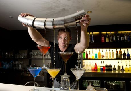 Shane Finnegan creates a cocktail tower.