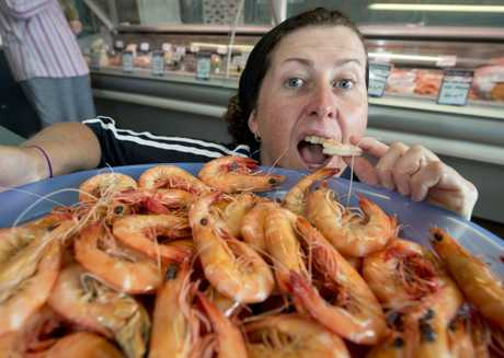 Megan Stone from Stoney the Fishmonger prepares to sell 1500kgs of prawns this Christmas.
