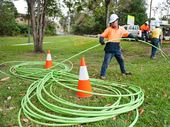 Silcar NBN Contractor Rick Graham handles keeps the cable running neatly on Joyce St. Photo: Rob Wright / The Coffs Coast Advocate
