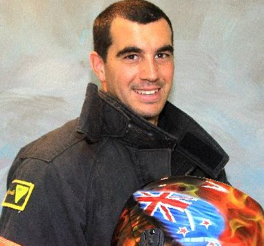 Te Awamutu firefighter Chris Bestwick with his custom painted helmet and (above) in action during a combat challenge.
