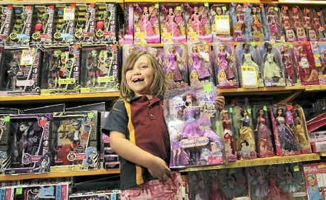Five-year-old Iliana Schmidt with some toys from Mr Toys Toyworld at Minyama.