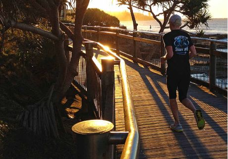 An early morning jogger at Happy Valley, Caloundra. Experts warn of preserving the Coasts character.