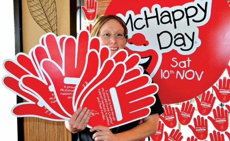 HIGH FIVE: McDonald's Warwick assistant manager Rebecca Smith still has several business sponsorship hands available for $10 with all proceeds going towards the McHappy Day fundraising total.