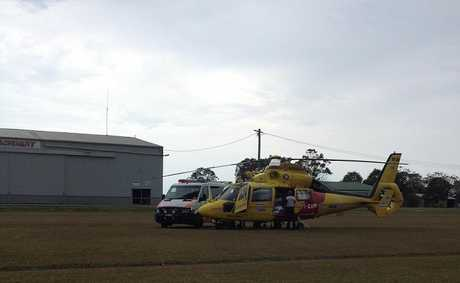 The Westpac Life Saver Rescue Helicopter prepares to airlift a woman injured when the car she was in left the Pacific Highway south of Wardell and crashed into the Richmond River.