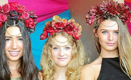DESIGNER SHOWCASE: Elke, April and Jana model hats by Anthea Nastesar at Eumundi Markets.